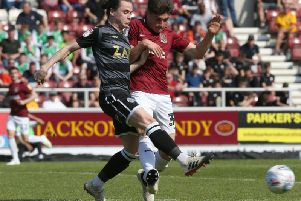 Scott Pollock gets a foot in during Friday's win over Macclesfield. Picture: Pete Norton