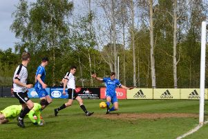 Mitchell Weiss finishes Kings' second goal on Saturday against Frome Town. (Picture by Chris Riddell).