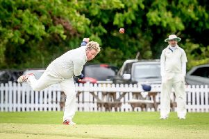 Fergus Deery bowling for Willoughby's second string on their league debut against Pytchley