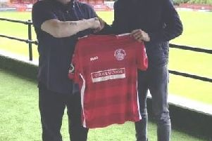 New Tudors' boss Sammy Moore's first signing Tosan Popo, right, with Hemel Hempstead Town chairman Dave Boggins.