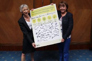 Louise Goldsmith and Deborah Urquhart with signed climate pledges from West Sussex county councillors
