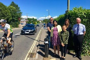 Ruby Lloyd, aged 11, shows MP Suella Braverman where she thinks a crossing should go on the Warsash Road.