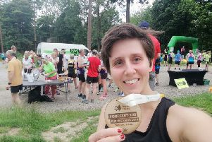 Gade Valley Harriers member Rossiana Mee with her medal after completing the Wendover Woods 10k event over the weekend.