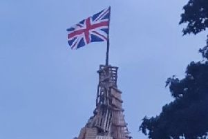 The Union Flag tops the bonfire at Drumbeg.