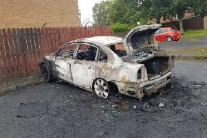 The burnt out car at Pinebank, Craigavon.