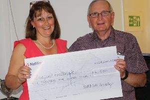 Sarah Broughton, Project Manager at Bedford Foodbank, receiving a cheque for �6,500 from Mike Chappell, Chairman of St Philip & St James Golf Society