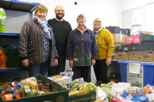 Lincs North Federation chairman Chris Morgan and fellow trustee Sara Carter (right) deliver the boxes of kindness to the Lincoln centre EMN-181127-082412001