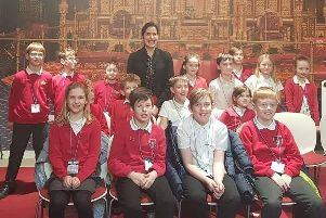 Victoria Atkins pictured with pupils.