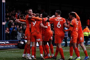 Luton celebrate James Collins' opening goal of the afternoon