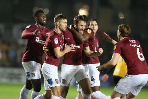 Cobblers celebrate Andy Williams' equaliser at Rodney Parade. Pictures: Pete Norton/Getty Images)