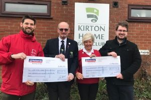 Pictured are Gary Burr, of the British Heart Foundation, and the Alzheimer's Association's Oliver Larkin receiving their cheques from 2018 Captain Barry Hunt and Ladies's. Captain Marlene Morris.