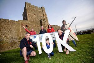 At the Storming the Castle launch are, (back) from left to right, Andy Smyth, Jack Creighton, the Mayor, Cllr Lindsay Millar and Neill Harper, Seapark AC; (front) Jack, Caroline and James Wasson (middle).