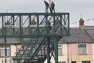 Children on top of the footbridge over the railway line in Lurgan