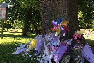 Flowers at the scene where the baby girl was found dead. Picture: Crimestoppers