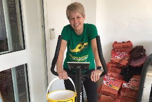 Sue Turner cycled at the  Co-Op Post Office branch in Market Rasen as part of her fundraising efforts. EMN-190104-133628001