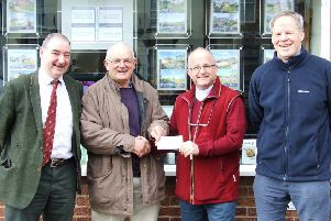 The cheque being presented by the Chairman of the Committee, Mike Harrison to the Rev Alan Robson on behalf of LRSN. Looking on are Richard Evison (Secretary) and Robert Bell (Treasurer). EMN-190416-095550001