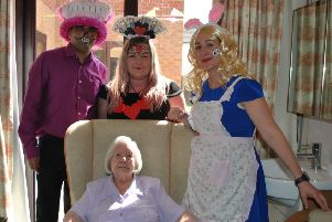 Eveline Annabel is pictured with staff at Toray Pines, in Coningsby, to celebrate her 104th birthday.