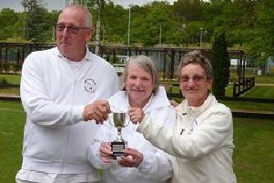 Paul Durkin and Jane Tewson receive the Lincoln Cup doubles trophy from Pauline Donner, chairperson of Woodhall Spa Croquet Club.