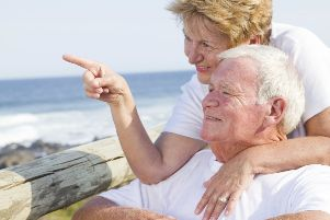 Elderly couple on the beach (stock image)