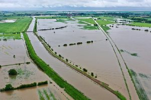 An aerial view of Wainfllet showing flooding on the train line.