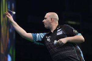 Rob Cross in action against Daryl Gurney during the Unibet Premier League Darts at the SSE Arena, Belfast. Picture by Michael Cooper