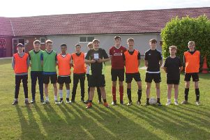 Woodhall Spa United FC under 14s proudly show off the trophy at the first training session of the new season.