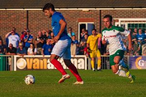 Calvin Davies tracks Gareth Evans during the Bognor-Pompey friendly of a year ago - the sides meet again this week but Davies is out, facing a long spell on the sidelines / Picture by Tommy McMillan
