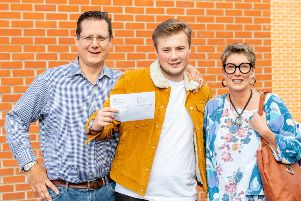 Smiling faces at QEGS as students and their parents collect A-Level results.