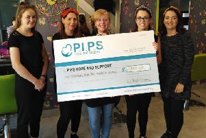 Orlaigh Stewart, Leon Mallen, Natalie Gorman, Jayne McKnight and Aideen Colgan pictured with the cheque inside Lil Miss Colour