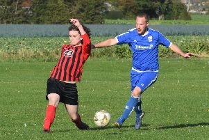 Benington (blue) v Woodhall Spa Res (red). Chris Lawson (blue), Jordan Barrand (red)