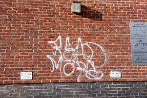 Graffiti on the wall of the town's library