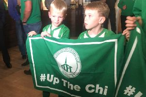 Two young Chi City fans ready for the draw and the TV cameras