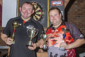 On the left is Shane Lowe, who retains his Singles title from last season. He is pictured with runner-up Pete Scott. Photo by Oscarpix Imaging.