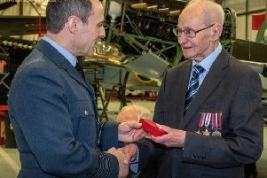 D-Day veteran Harry Archer receives his award from Station Commander Group Captain Mark Flewin