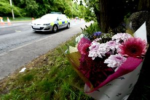 Floral tributes...have become all too commonplace on the Scottish road network but the statistics here do offer some hope for the future.