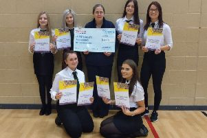 Members of the Kemnay Academy Rock Challenge Team accept the donation from Lynn Murphy of Tesco