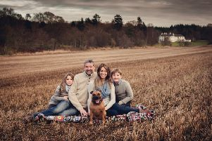 Business owners Tim and Stef Erbe with children Alex and Amy and their dog, Ginger, at the Logie Country House estate