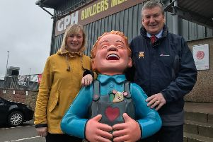 Katie Kyle of The ARCHIE Foundation and the charity's 'Brave Wee Boy' statue on a visit to GPH Builders Merchants