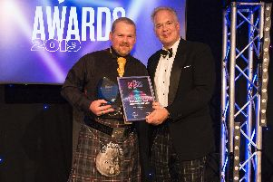 Raymond Henderson of RH Electrical being presented the award by Mark Hodson of sponsor ECIC