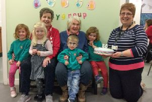 Elma Napier and Anthea Whitelaw with manager Alison Murphy and some playgroup youngsters