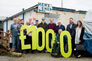 Members of Inverurie & District Men's Shed accept the donation from Barratt Homes