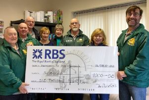 The Auld-GITS present their cheque donation to members of Inverurie Foodbank
