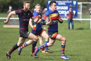 Leamington fly-half Richard McKowen outpaces the Evesham defence. Pictures: Ken Pinfold