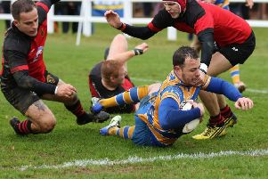 Simon Hemming goes over for OLs. Pictures: Tim Nunan