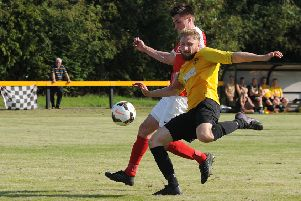 Rich Powell, seen here in action against Pegasus Juniors, opened the scoring for Racing Club