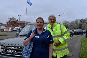 Graeme Wright (right) with clinical sister Sarah Rawlings outside Warwick Hospital with a 4x4