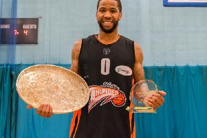 Jorge Ebanks with the National Trophy and MVP award. Picture: Kyle Hemsley