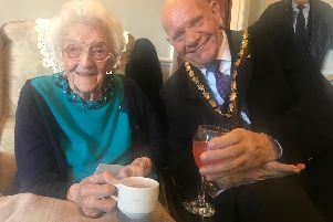 Gladys Waite celebrating her 107th birthday with the Mayor of Skegness Coun Sid Dennis.