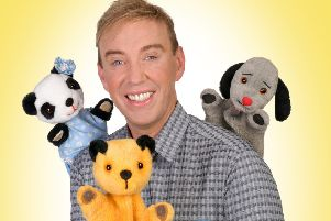 Richard Cadell with Sooty, Sweep and Soo. Picture by Steve Ullathorne