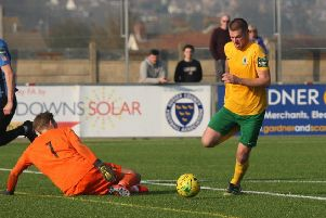 Horsham v Sevenoaks. Rob O'Toole rounds the goalkeeper to slot away his second goal. Picture by John Lines